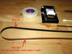 Typical back coated tape, brown on the oxide side, black or charcoal gray on the back side
